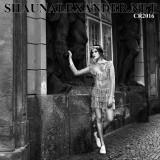 high contrast black and white fashion photographs of a beautiful young model posing for shaun alexander in prague
